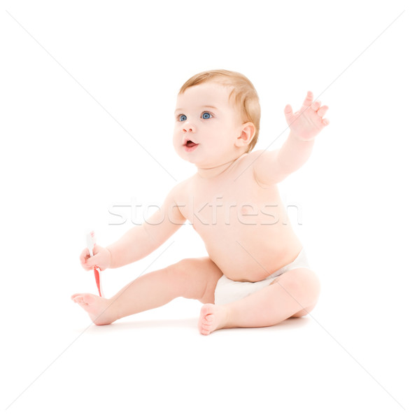 Stock photo: baby boy in diaper with toothbrush