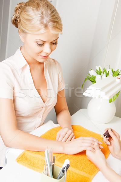 woman having a manicure at the salon Stock photo © dolgachov