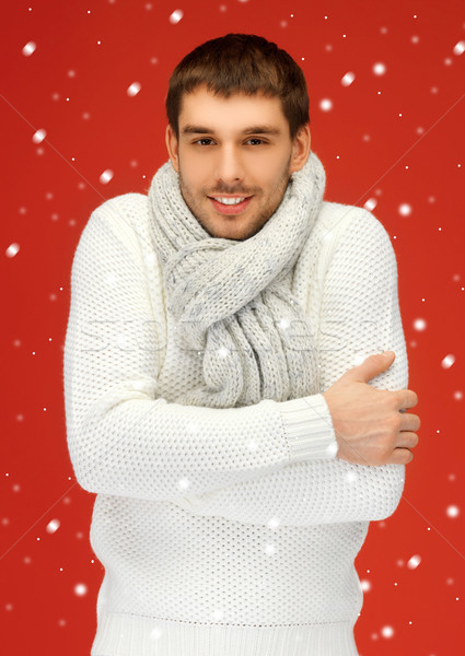 handsome man in warm sweater and scarf Stock photo © dolgachov