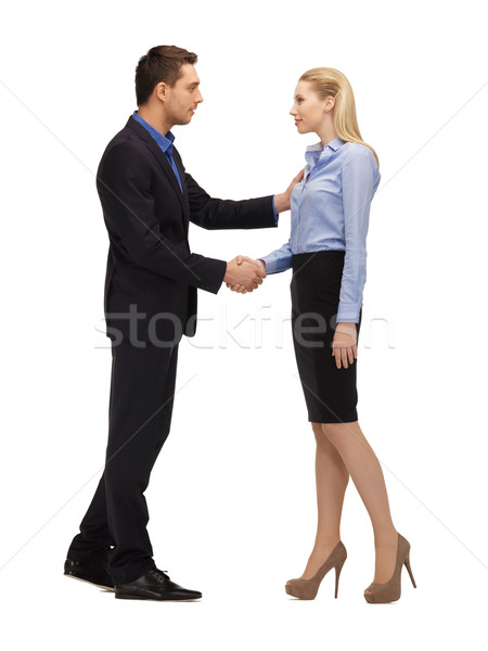 man and woman shaking their hands Stock photo © dolgachov