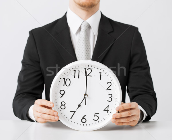 man with wall clock Stock photo © dolgachov