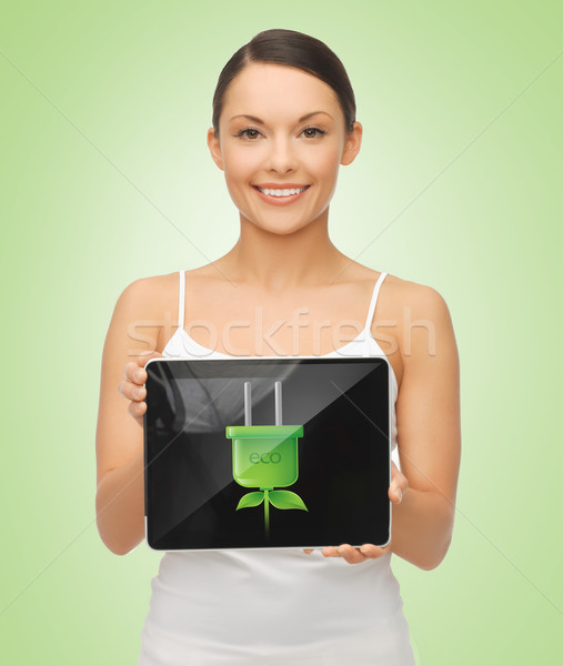 woman holding tablet pc with green electrical plug Stock photo © dolgachov