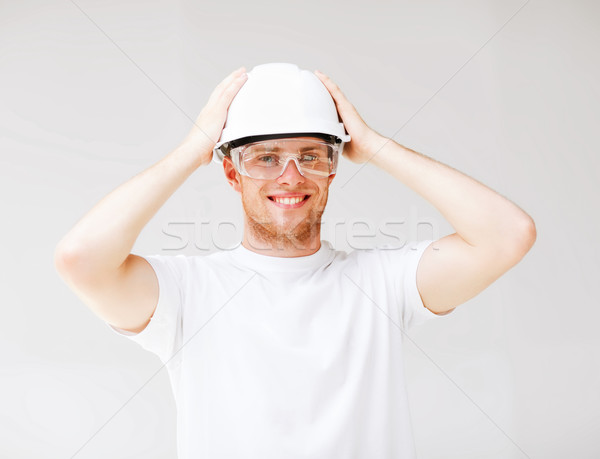 male architect in helmet with safety glasses Stock photo © dolgachov