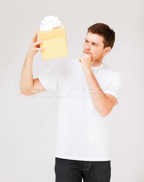 man in white t-shirt with gift box Stock photo © dolgachov