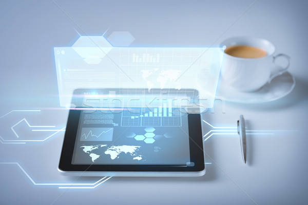 Stock photo: tablet pc and virtual screen