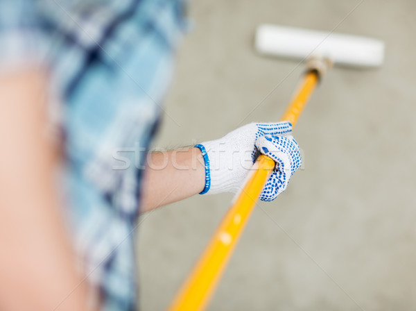 man colouring the wall with roller Stock photo © dolgachov