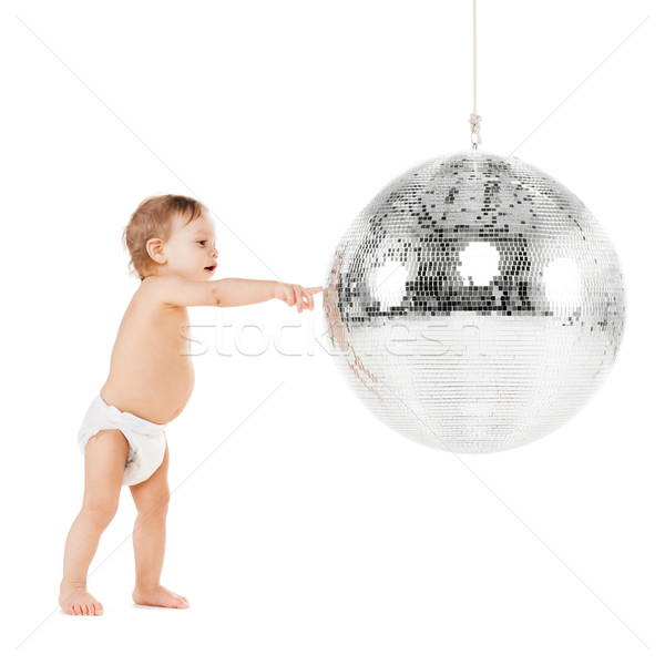 toddler playing with disco ball Stock photo © dolgachov