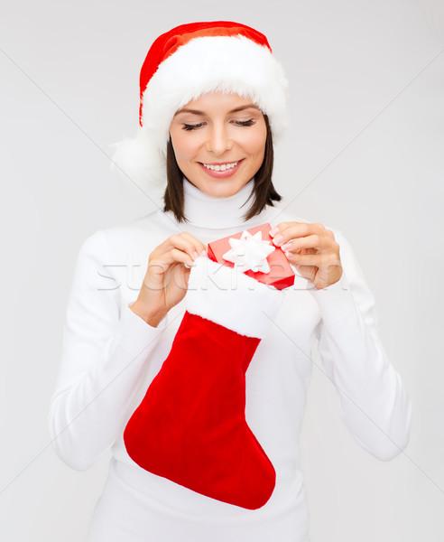 女性 サンタクロース 帽子 ギフトボックス ストッキング クリスマス ストックフォト © dolgachov