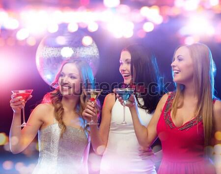 Trzy uśmiechnięty kobiet taniec klub strony Zdjęcia stock © dolgachov