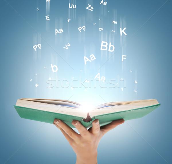 Hand Open boek magie lichten onderwijs Stockfoto © dolgachov