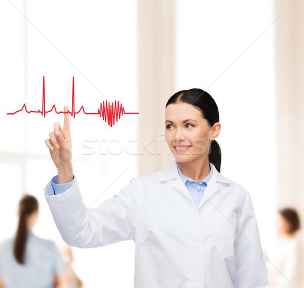 Mosolyog női orvos mutat kardiogram egészségügy Stock fotó © dolgachov