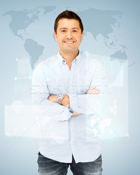 handsome smiling man Stock photo © dolgachov