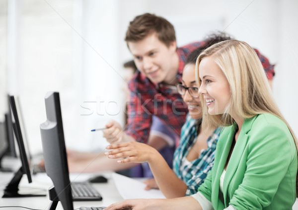 students with computer studying at school Stock photo © dolgachov