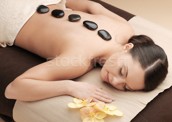 asian woman in spa with hot stones Stock photo © dolgachov