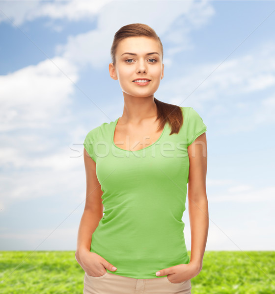 Mosolyog fiatal nő zöld póló terv emberek Stock fotó © dolgachov