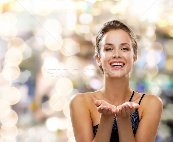 Risonho mulher vestido de noite algo pessoas Foto stock © dolgachov