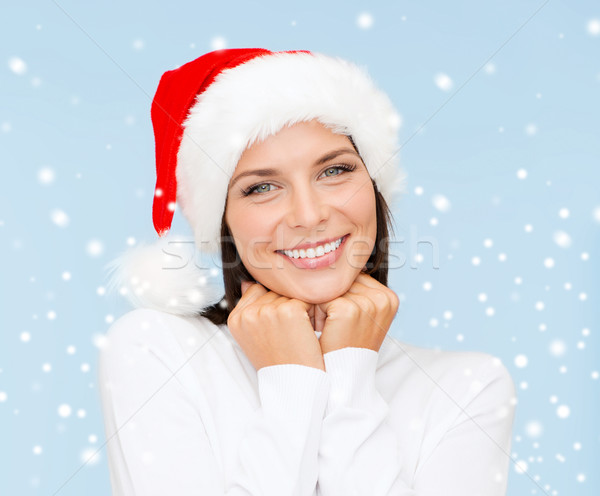 Gülümseyen kadın yardımcı şapka Noel noel Stok fotoğraf © dolgachov