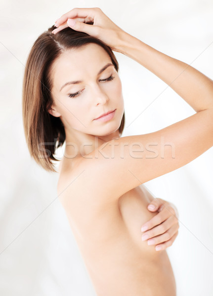 woman checking breast for signs of cancer Stock photo © dolgachov