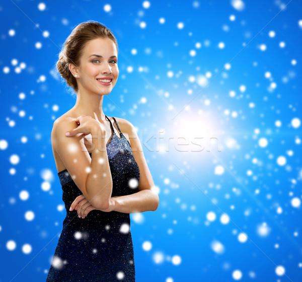 Mosolygó nő estélyi ruha emberek ünnepek karácsony kék Stock fotó © dolgachov