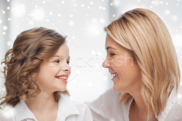 happy mother and daughter talking Stock photo © dolgachov