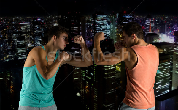 Stock photo: young men fighting hand-to-hand