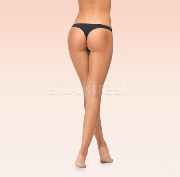 close up of female legs in black bikini panties Stock photo © dolgachov