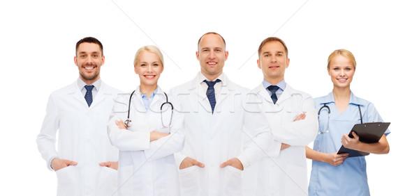 Groupe médecins presse-papiers santé personnes médecine Photo stock © dolgachov