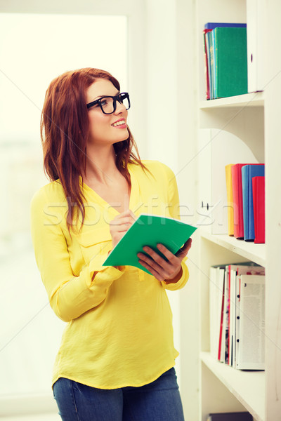 female student in eyeglasses with textbook Stock photo © dolgachov