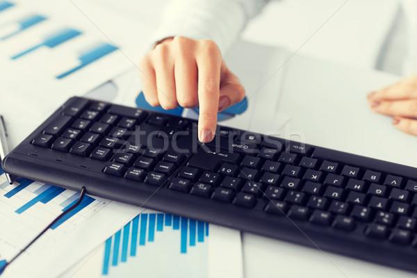 woman hand pressing enter button on keyboard Stock photo © dolgachov