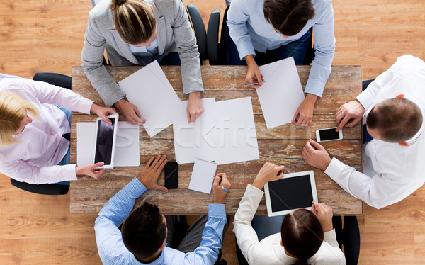 close up of business team with papers and gadgets Stock photo © dolgachov