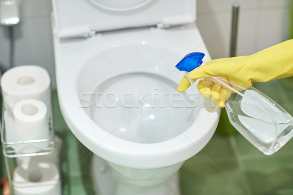 close up of hand with detergent cleaning toilet Stock photo © dolgachov