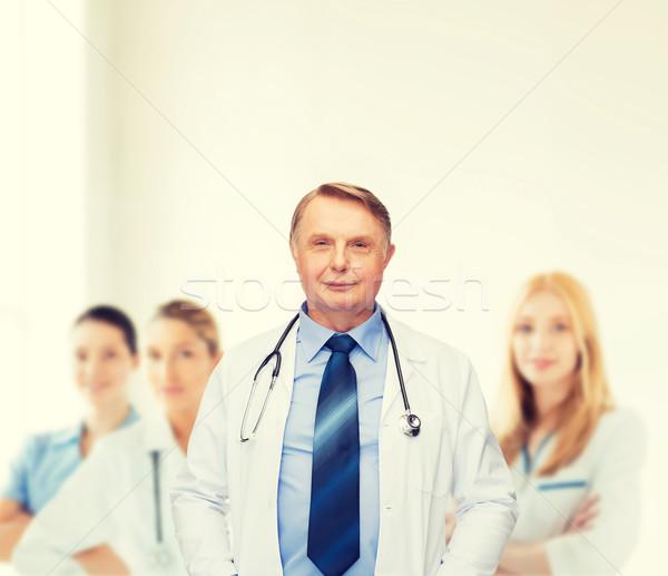 smiling doctor or professor with stethoscope Stock photo © dolgachov