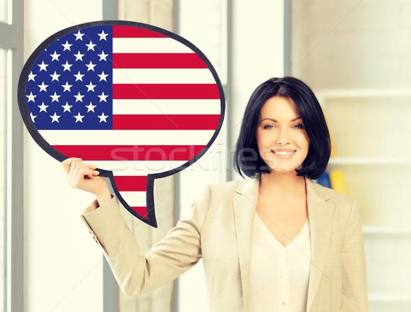 Uśmiechnięta kobieta tekst Bańka amerykańską flagę edukacji obcy Zdjęcia stock © dolgachov