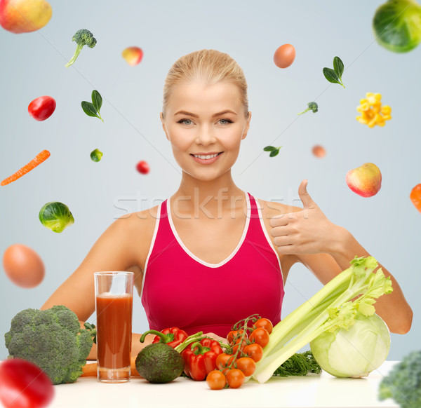 happy woman with vegetarian food showing thumbs up Stock photo © dolgachov