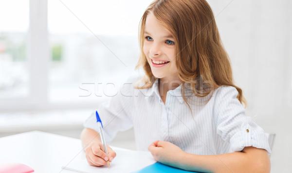Student dziewczyna piśmie notebooka szkoły edukacji Zdjęcia stock © dolgachov
