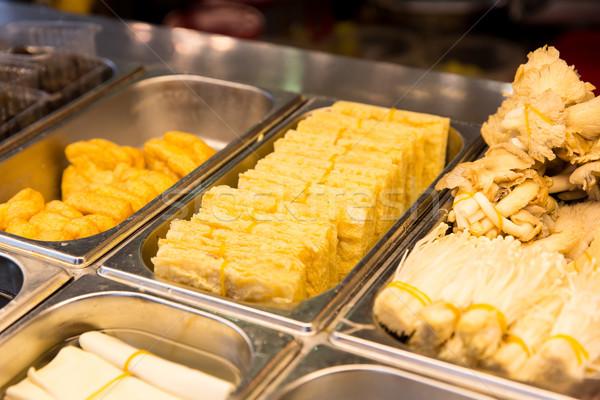 spring rolls and snacks at street market Stock photo © dolgachov