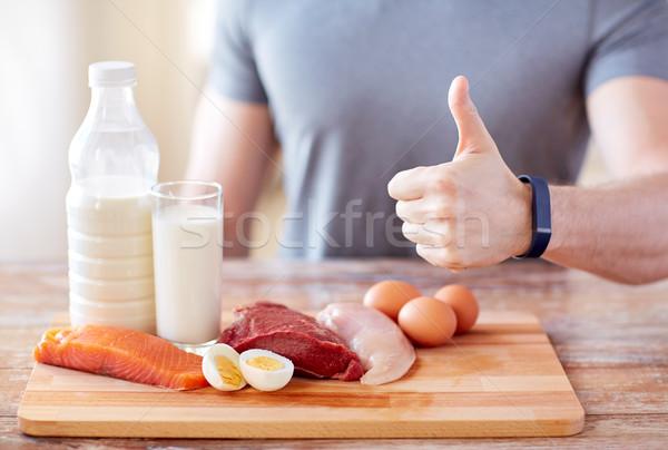 Férfi étel gazdag fehérje mutat remek Stock fotó © dolgachov