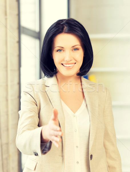 woman with an open hand ready for handshake Stock photo © dolgachov