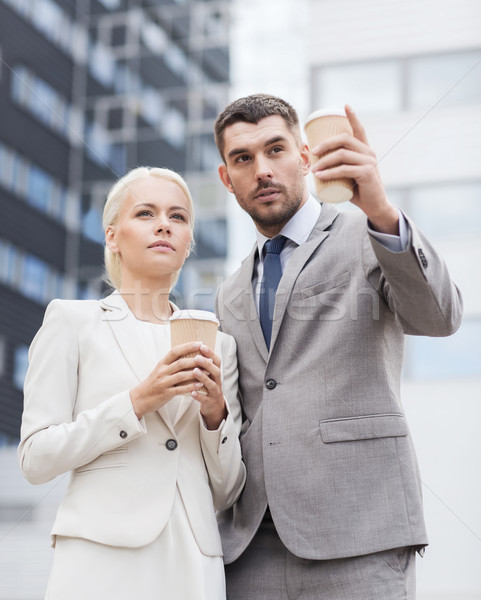 serious businessmen with paper cups outdoors Stock photo © dolgachov