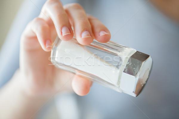Közelkép kéz tart fehér só pince Stock fotó © dolgachov