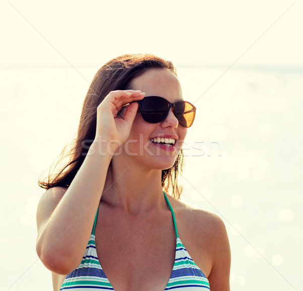 smiling teenage girl in sunglasses Stock photo © dolgachov