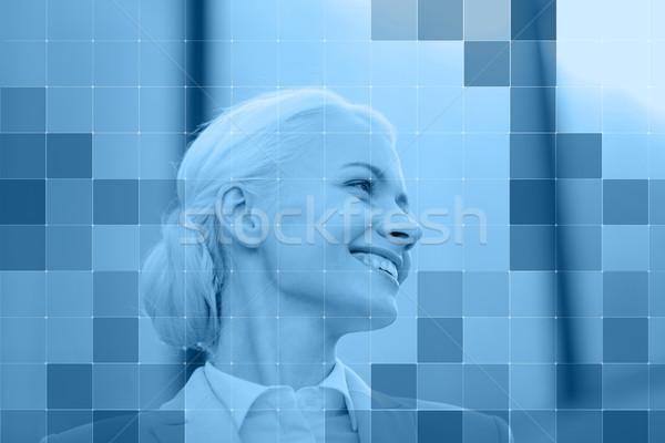 Sorridente empresária atrás monocromático azul grade Foto stock © dolgachov