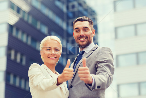 Stock photo: smiling businessmen showing thumbs up