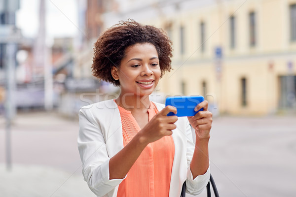 Felice african imprenditrice smartphone business tecnologia Foto d'archivio © dolgachov