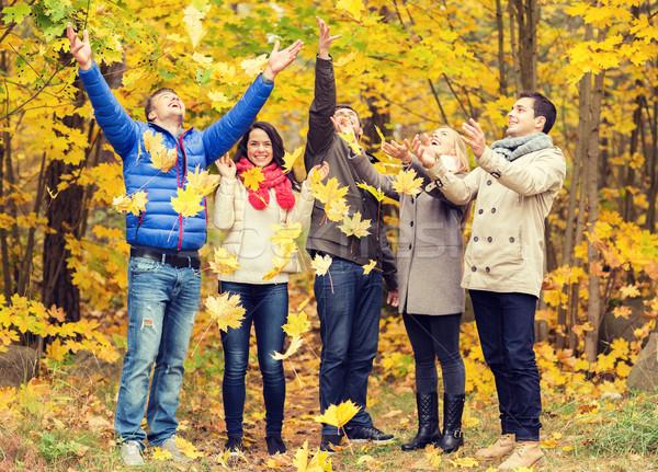 Csoport mosolyog férfiak nők ősz park Stock fotó © dolgachov