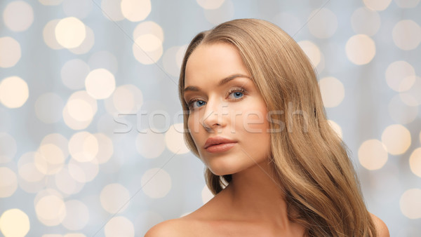beautiful young woman face over holidays lights Stock photo © dolgachov