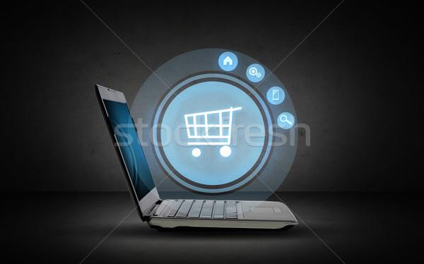 Computador portátil carrinho de compras ícone projeção tecnologia negócio Foto stock © dolgachov
