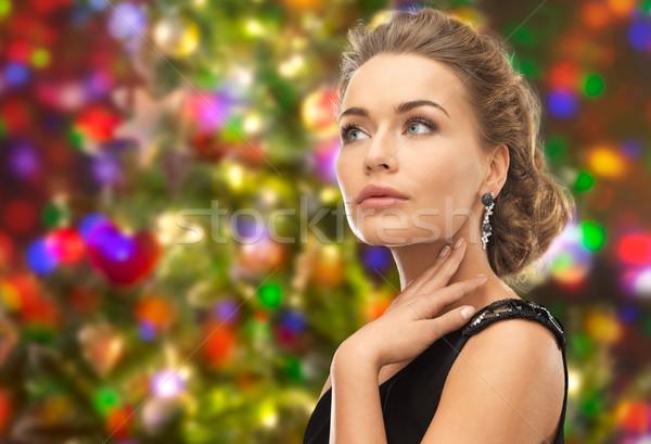 Piękna kobieta kolczyki światła ludzi wakacje Zdjęcia stock © dolgachov