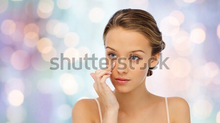 Stock photo: smiling woman with diamond ring