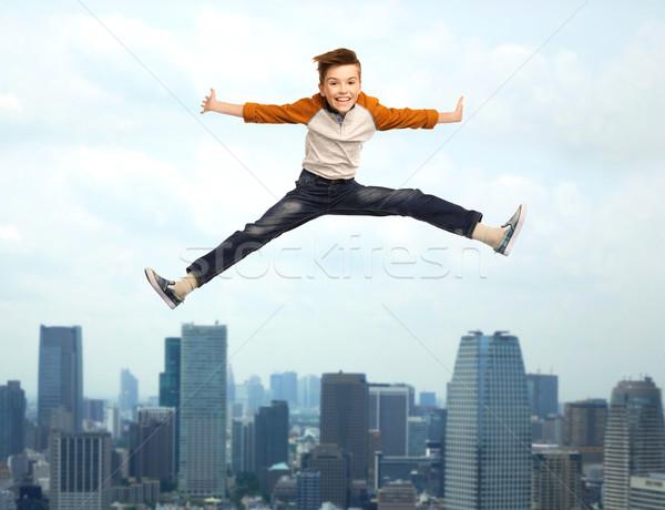 happy smiling boy jumping in air Stock photo © dolgachov